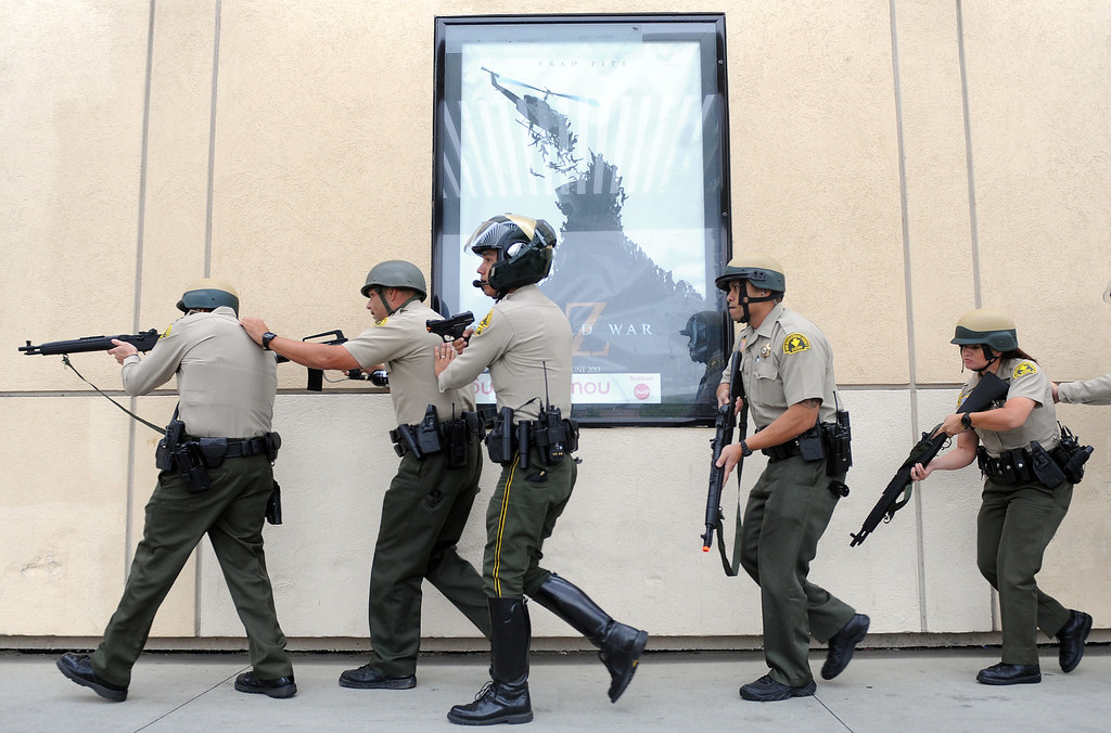 Description of . (Will Lester/Inland Valley Daily Bulletin) Rancho Cucamonga Sheriff deputies approach the theaters side entrance during a mock theater shooting training drill Thursday morning August 1, 2013 at Victoria Gardens in Rancho Cucamonga.