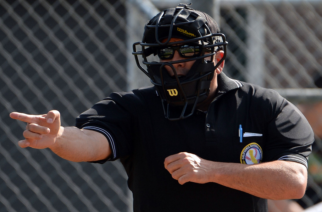 Description of . Home plate umpire calls a strike in the second inning of the Arcadia Elk Baseball Tournament between Alhambra and Monrovia at Monrovia High School in Monrovia, Calif., on Thursday, March 13, 2014. Monrovia won 2-0.  (Keith Birmingham Pasadena Star-News)