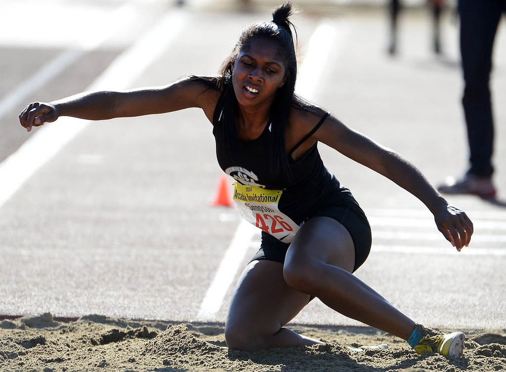 Description of . Carson's Candace Simpson in the triple jump during the Arcadia Invitational track and field meet at Arcadia High School in Arcadia, Calif., on Friday, April 11, 2014.  (Keith Birmingham Pasadena Star-News)