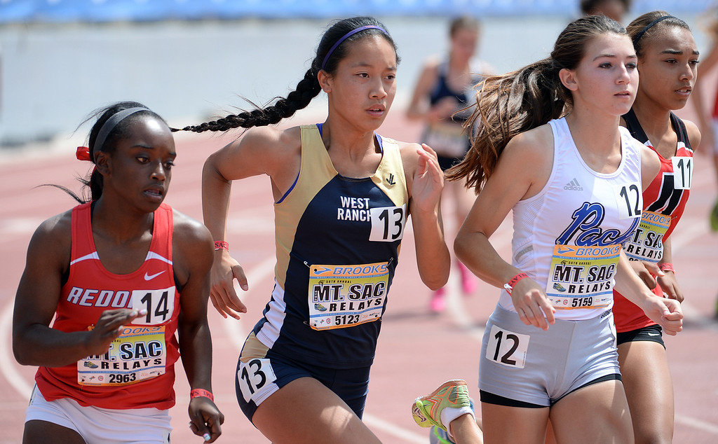 Description of . West Ranch's Marisa Magsani (13) competes in the 800 meter run Invitational during the Mt. SAC Relays in Hilmer Lodge Stadium on the campus of Mt. San Antonio College in Walnut, Calif., on Saturday, April 19, 2014. 