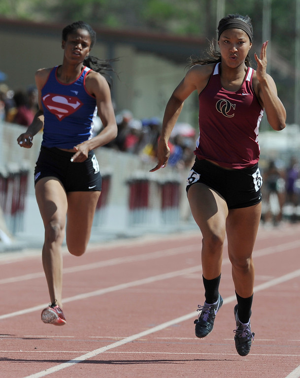 Description of . Megan George from Serra can not catch Schuyler Moore from Oaks Christion. Moore won the girls 100 meters in the 2013 CIF Southern Section Track & Field Divisional Finals held at Mt. San Antonio College in Walnut, CA 5/18/2013(John McCoy/LA Daily News)