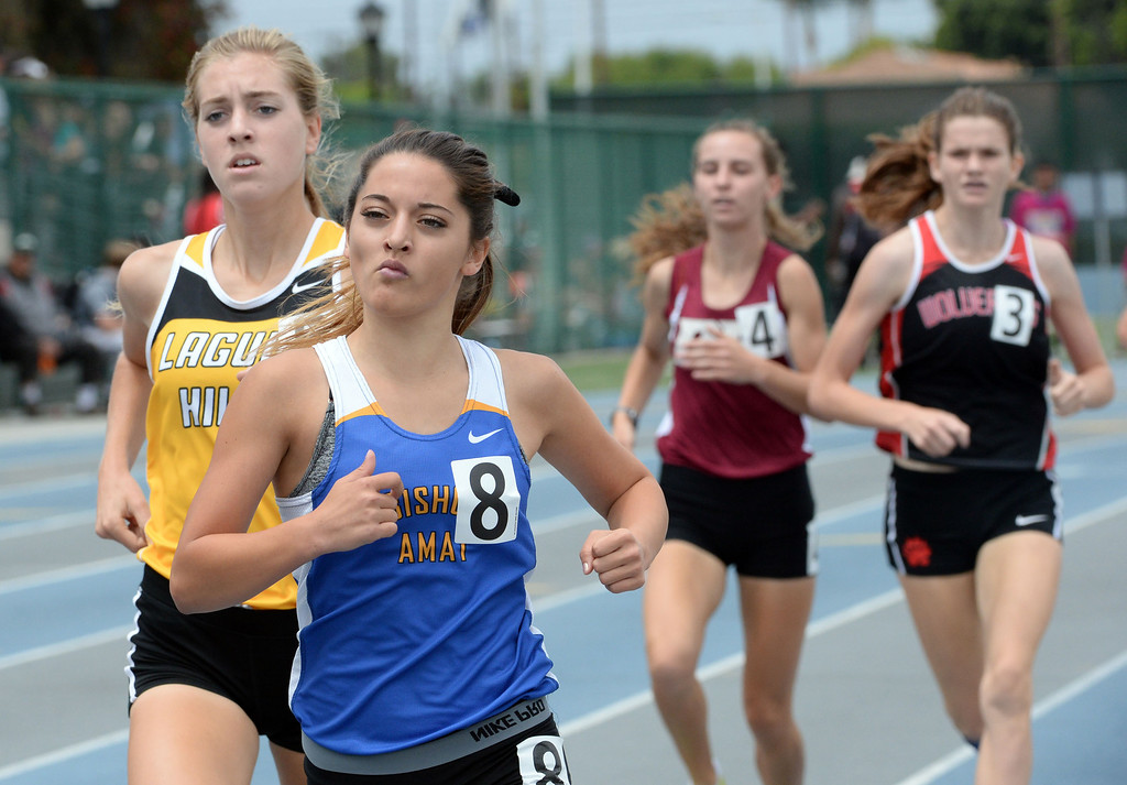 Description of . Bishop Amat's Emily Hubert competes in the division 3 1600 meter race during the CIF Southern Section track and final Championships at Cerritos College in Norwalk, Calif., Saturday, May 24, 2014. 