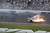 Kyle Larson (32) crashes at the conclusion of the NASCAR Nationwide Series auto race Sunday, Feb. 24, 2013, at Daytona International Speedway in Daytona Beach, Fla. (AP Photo/Chris O'Meara)