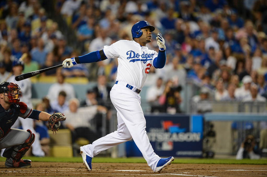 Description of . Dodgers' Carl Crawford hits a homer at his first at bat in game 4 against Atlanta  Monday, October 7, 2013 ( Photo by Hans Gutknecht/Los Angeles Daily News )