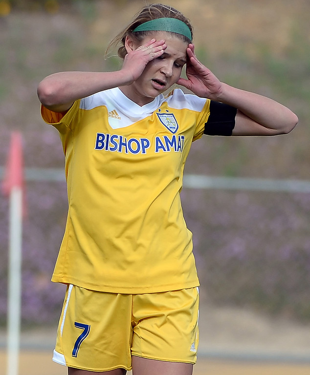 Description of . Bishop Amat's Sophia Serafin reacts after missing on a penalty kick against Diamond Bar in the first half of a CIF-SS second round prep playoff soccer match at Diamond Bar High School in Diamond Bar, Calif., on Wednesday, Feb.26, 2014. Diamond Bar won 3-2.