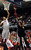 (3-2-13)--Anaheim-Sports- Mater Dei's #4 Elijah Brown, left, tries to block Etiwanda's #23 Kennieth Barnes shot in the Second quarter Saturday March 2, 2013 during the CIF Ford Southren Section Boy's Division 1AA Final Championship at the Anaheim Convention Center in Anaheim.LaFonzo Carter/ Staff Photographer