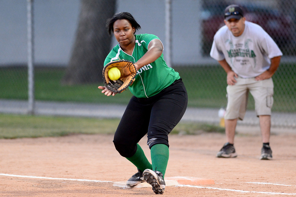 Description of . Monrovia's Derek Blow (21) makes an out at first  during the West SGV softball all-star game Wednesday night, June 11, 2014 at Live Oak Park in Temple City. (Photo by Sarah Reingewirtz/Pasadena Star-News)