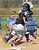 California's Sierra Rodriguez (#25) gets tagged out at home by Bell Gardens' catcher Daisy Calvary (#9) in their non-league game at California High School in Whittier on Thursday March 14, 2013. California beat Bell Gardens 10-0 in five innings. (SGVN/Staff Photo by Keith Durflinger)