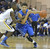 LONG BEACH, CALIF. USA -- Millikan's Sam Brayboy (15) tries to stop Gahr's Anthony Austin (15) during their CIF-SS Divison 1-A playoff game in Long Beach on February 15, 2013. Millikan defeated Gahr, 74 to 64. Photo by Jeff Gritchen / Los Angeles Newspaper Group