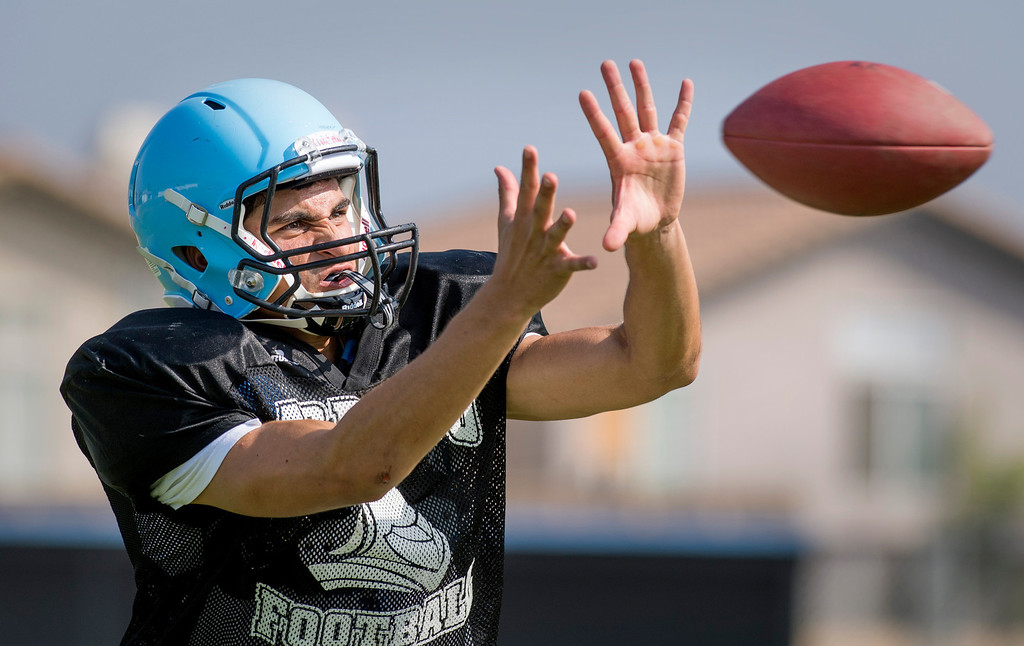Description of . Arroyo High WR David Cotero hauls in a pass during preseason practice at the El Monte campus August 14, 2013.   (SGVN/Staff photo by Leo Jarzomb)