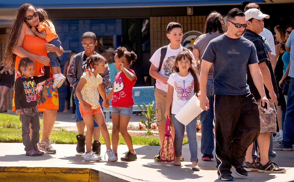 Description of . Parents pick up Hermosa Elementary School students evacuating due to the Etiwanda Fire in Ranco Cucamonga, Calif. April 30, 2014.  (Staff photo by Leo Jarzomb/San Gabriel Valley Tribune)