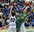 Long Beach Poly's Jada Matthews (22) drives to the basket past Bishop Amat's Janae Chamois (20) in the first half of a CIF State Southern California Regional semifinal basketball game at Bishop Amat High School on Tuesday, March 12, 2013 in La Puente, Calif. Long Beach Poly won 52-34. 
