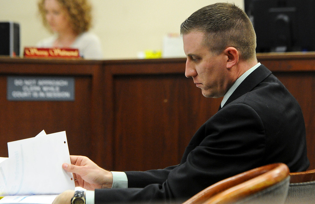 Description of . Former San Bernardino County sheriff's deputy Nathan Gastineau, who is suspected of having sex with a teen Explorer, shuffles papers around during closing arguments of his trial at San Bernardino Superior Court in San Bernardino, CA on Tuesday, Jan. 28, 2014. (Photo by Rachel Luna / San Bernardino Sun)
