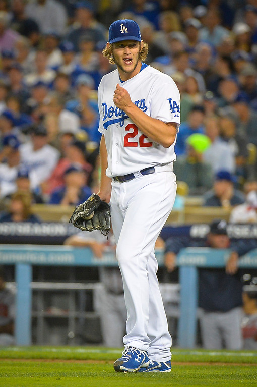 Description of . Dodgers' Clayton Kershaw reacts to a strike out against Atlanta during game action Monday, October 7, 2013 ( Photo by Andy Holzman/Los Angeles Daily News )