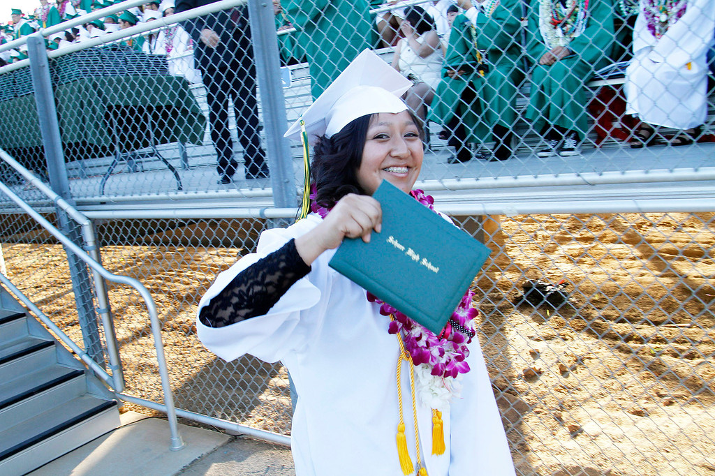Description of . Daisy Burgos receives her diploma in