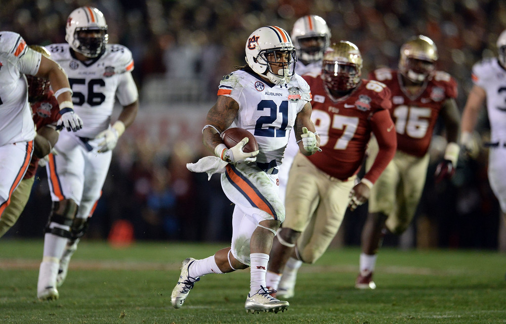 Description of . Auburn running back Tre Mason (21) runs for a touchdown against Florida State in the fourth quarter of the BCS National Championship game at the Rose Bowl in Pasadena, Calif., on Monday, Jan. 6, 2014. Florida State won 34-31.