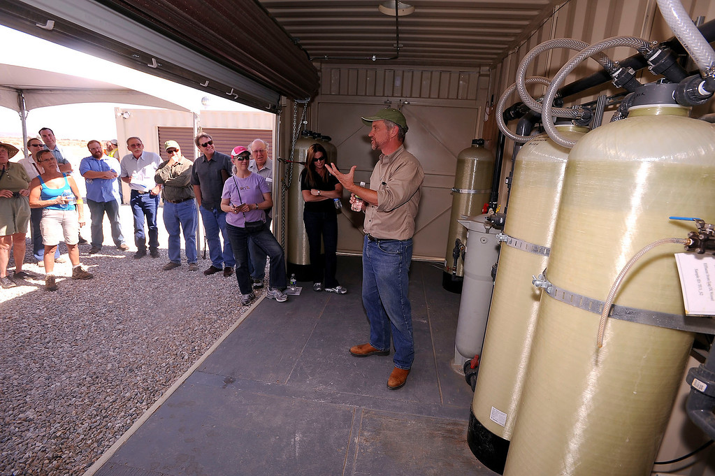 Description of . Kevin Sullivan of Pacific Gas and Electric Company speaks to a tour group about a Whole House Water system at an agriculture unit in Hinkley June 13, 2012.   GABRIEL LUIS ACOSTA/STAFF PHOTOGRAPHER.