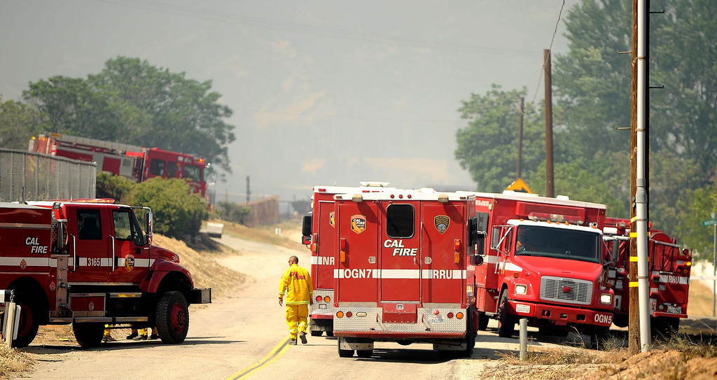 Description of . Firefighters  battle a 3,000 acres Summit Fire that's burning along Sunset Avenue in Banning May 1, 2013. The fire is only 35% contained. Strike teams and crews from a number of fire agencies including San Bernardino County Fire, Los Angeles County Fire, Orange County Fire, Cal Fire, Chino Valley Fire, Rancho Cucamonga Fire and San Antonio Heights Fire  responded to the blaze which caused evacuations.LaFonzo Carter/ Staff Photographer