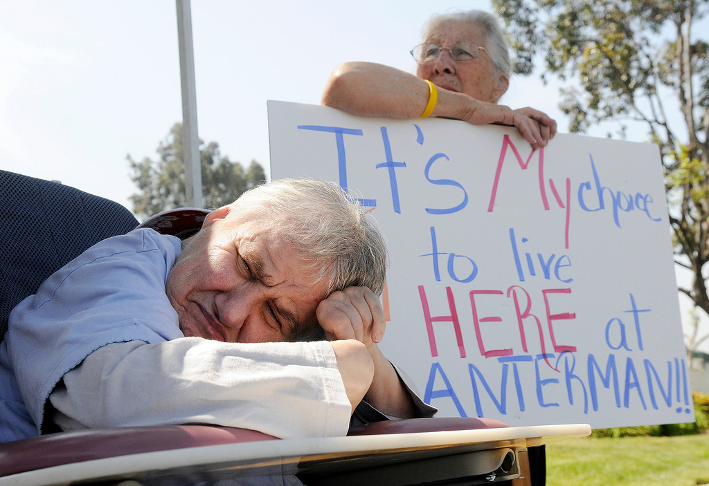Description of . ON27-LANTERMAN-04-WL  (Will Lester/Staff Photographer) Patricia Moody (left), who is developmentally disabled and been a resident at the Lanterman Deveopmental Center in Pomona for 57 years, sits in her wheelchair as her sister Giggs Moody (right), from Yorba Linda, protests  Monday April 26, 2010 in Diamond Bar. Approximately 75 protesters gathered outside the facility to voice their opposition to the state's desire to begin closing the facility by the end of this year.