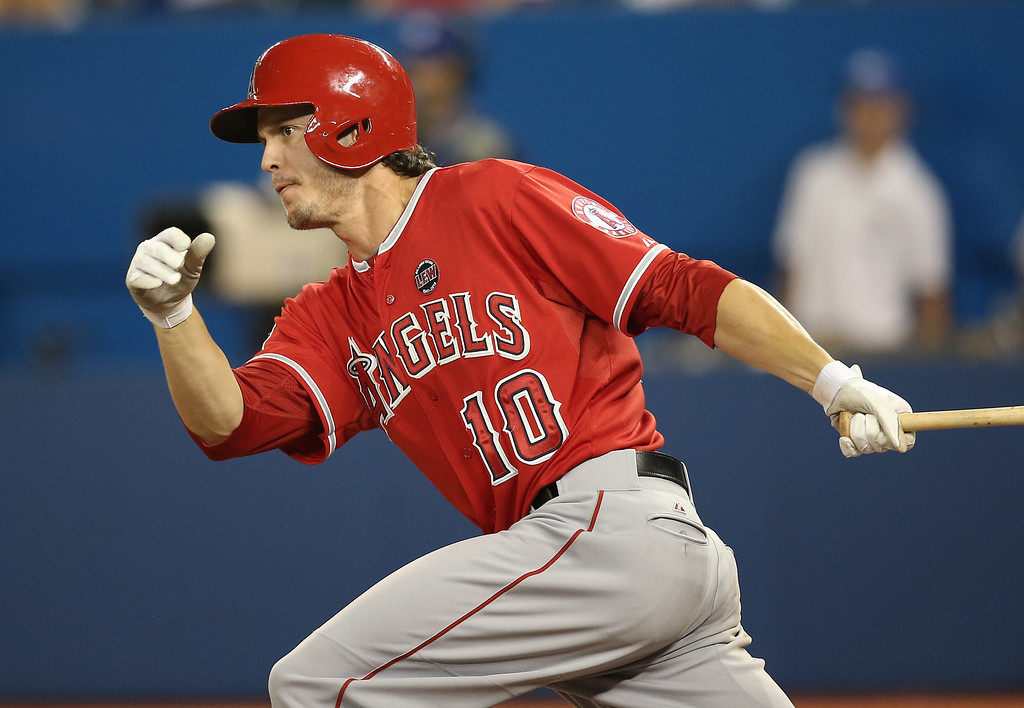 Description of . TORONTO, CANADA - SEPTEMBER 11: Grant Green #10 of the Los Angeles Angels of Anaheim hits a double in the fifth inning during MLB game action against the Toronto Blue Jays on September 11, 2013 at Rogers Centre in Toronto, Ontario, Canada. (Photo by Tom Szczerbowski/Getty Images)