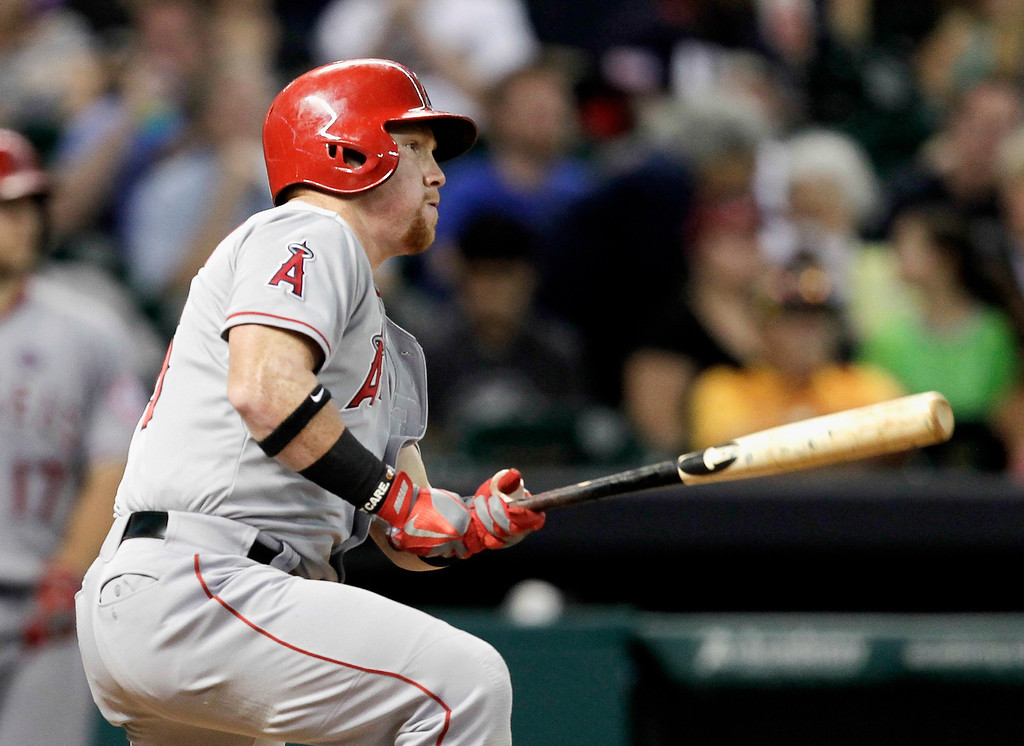Description of . HOUSTON, TX - SEPTEMBER 14:  Kole Calhoun #56 of the Los Angeles Angels of Anaheim doubles in the fourth inning against the Houston Astros at Minute Maid Park on September 14, 2013 in Houston, Texas.  (Photo by Bob Levey/Getty Images)
