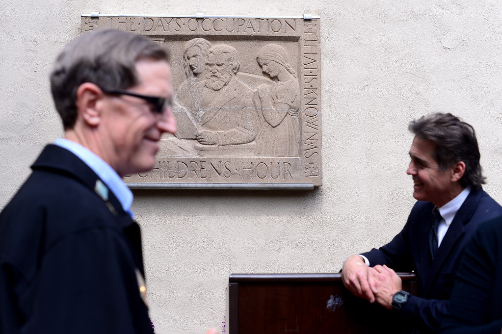"Description of . Public officials attend the unveiling of Merrell Gage's recently restored 1930 bas relief masterpiece, ""The Children's Hour"" at South Pasadena Public Library Friday, March 21, 2014. The 600 lb. stone casting survived fire, breakage, and being buried until it was deemed to possess great local and national significance. (Photo by Sarah Reingewirtz/Pasadena Star-News)"