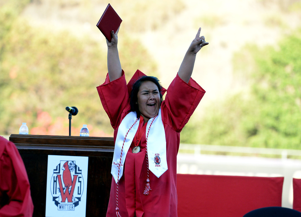Description of . Graduate Nicole Garcia reacts after receiving her diploma during the Whittier High School graduation at Whittier College in Whittier, Calif., on Wednesday, June 4, 2014.  (Keith Birmingham/Pasadena Star-News)