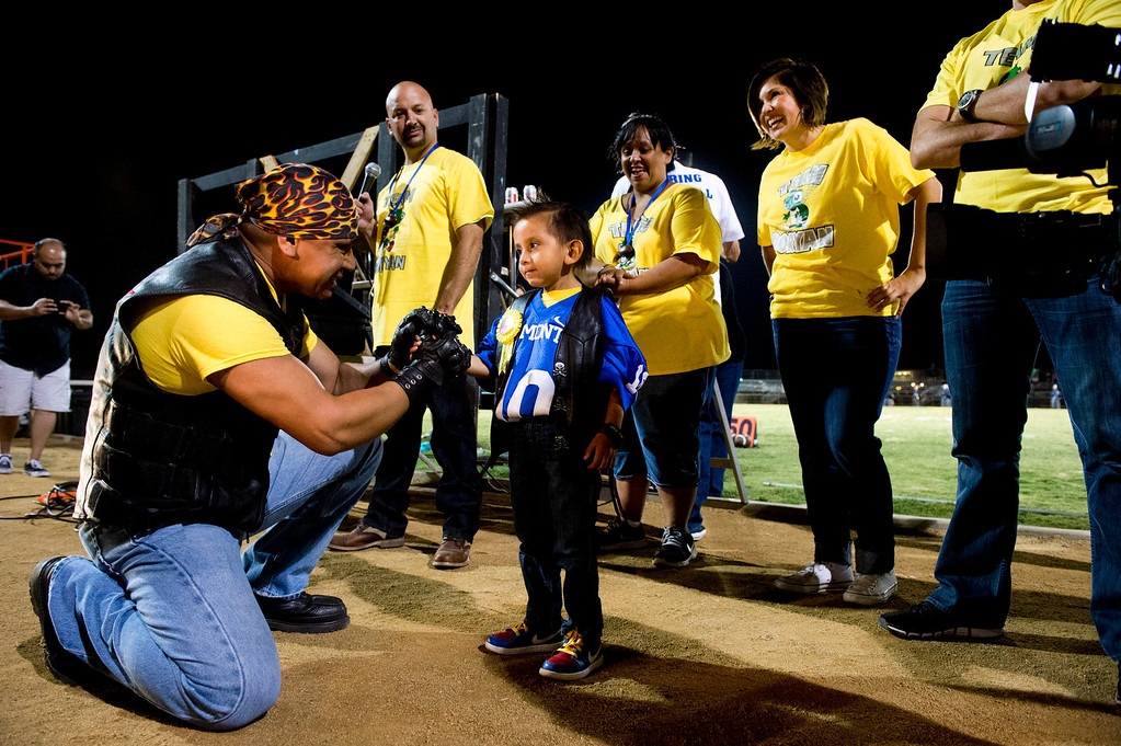 Description of . Five-year-old Doryan Torres is honored during the El Monte High School football halftime special in El Monte on Friday night, Sept. 13, 2013. Torres who is turning 6 on Saturday, has been battling a brain tumor since he was 14 months old. (Photo by Watchara Phomicinda/ San Gabriel Valley Tribune)