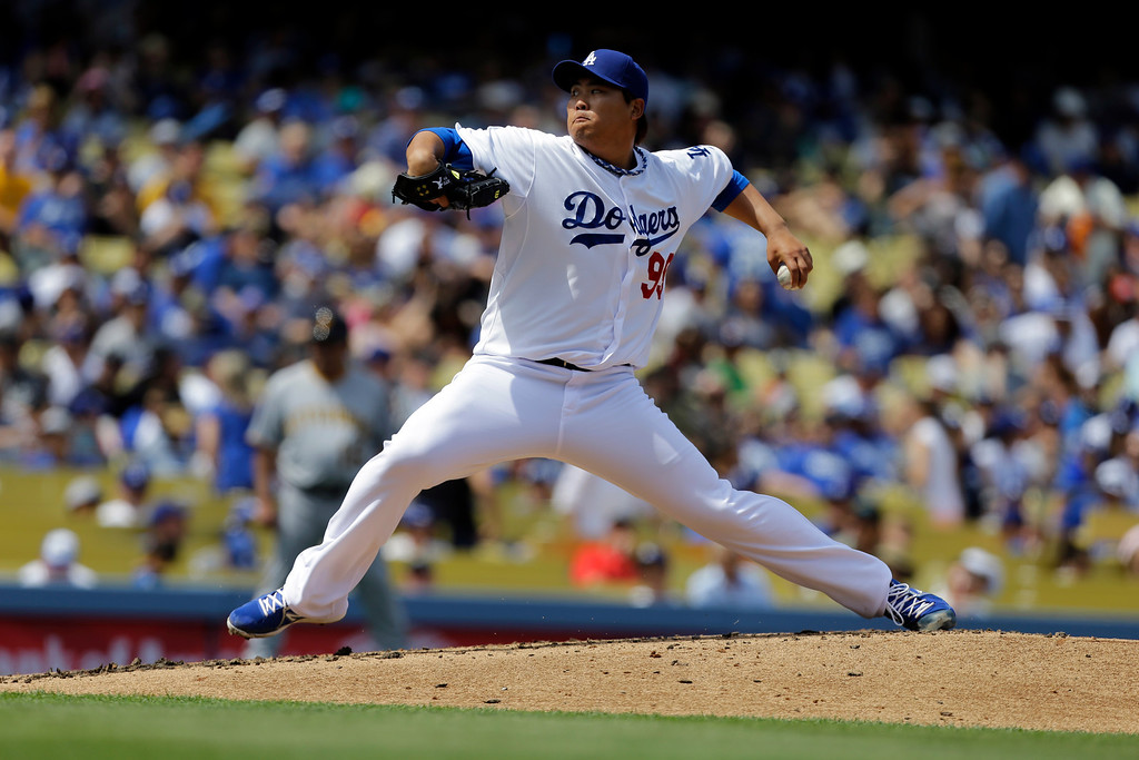 Description of . Dodgers pitcher Hyun-Jin Ryu, of South Korea, in a baseball game between the Pittsburgh Pirates and Los Angeles Dodgers in Los Angeles Sunday, April 7, 2013. Ryu won his MLB debut for the Dodgers, 6-2.   (AP Photo/Reed Saxon)