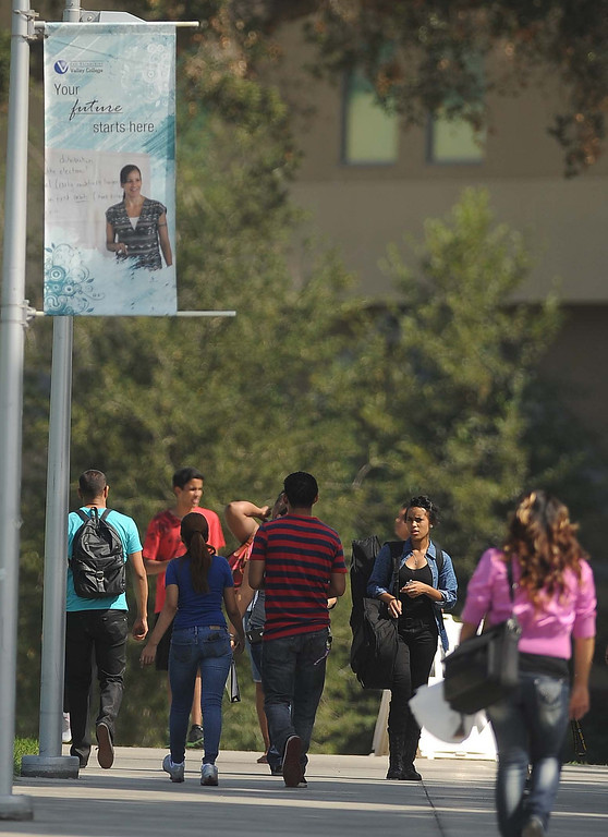 Description of . San Bernardino Valley College students returning  back to school after the summer break Monday August 19, 2013 in San Bernardino.LaFonzo Carter/ Staff Photographer
