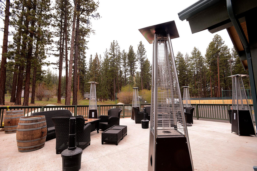 Description of . A view of the outdoor seating the Stone Summit Winery & Vineyards in Big Bear Lake May 6, 2013.  The winery is one of the ways developer David Stone is trying to transform Big Bear into a more upscale tourist town.  GABRIEL LUIS ACOSTA/STAFF PHOTOGRAPHER.