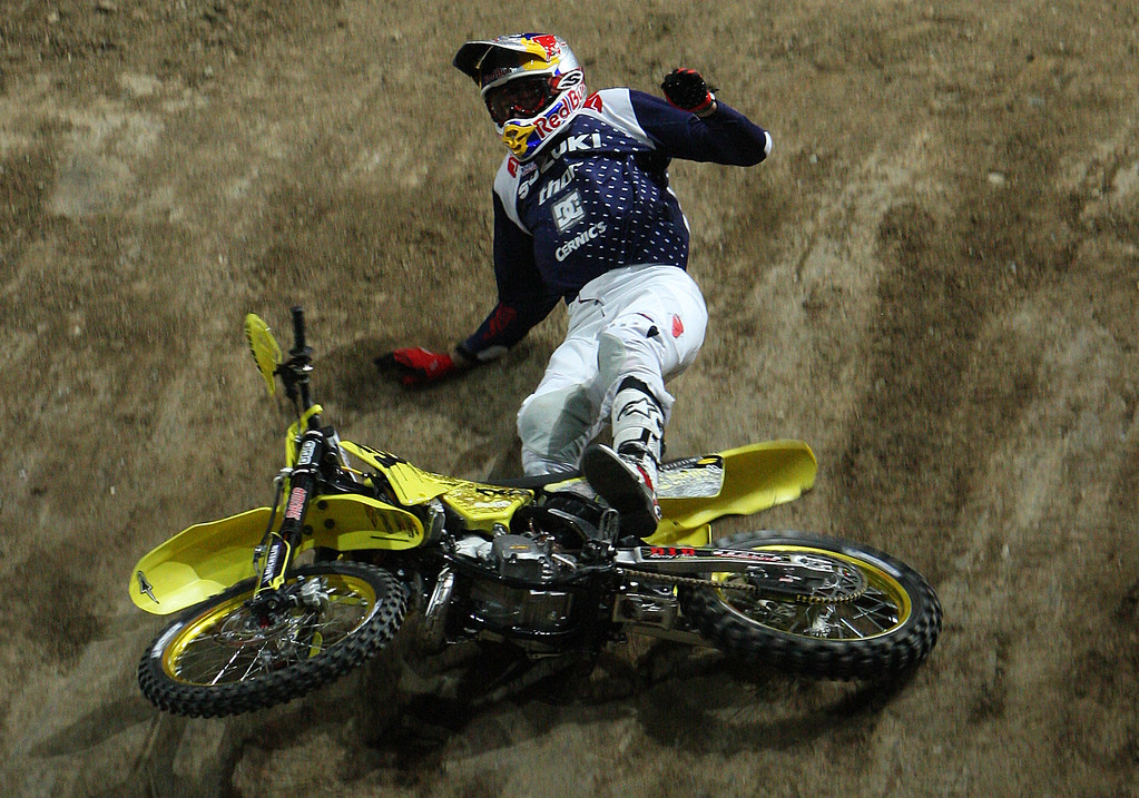 Description of . Travis Pastrana crashes on his first and only run of the night during X Games Fifteen Motocross Best Trick Finals at the Staples Center on Friday, July 31, 2009 in Los Angeles,Calif. (SGVN/Staff Photo by Keith Birmingham/SPORTS)