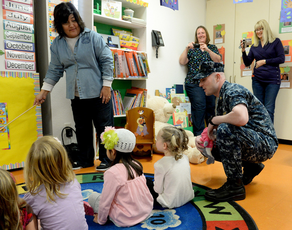 Description of . Navy Chief Nick Elliot who's been deployed for five month, surprised his four-year-old daughter Alexis in her classroom at First Lutheran Children's Center in Redlands,CA. Thursday, Nov. 21, 2013. Elliot's was deployed overseas, serving in the Persian Golf on the USS Harry S. Truman, this was the longest he has ever been away from his family. (John Valenzuela/Staff Photographer)