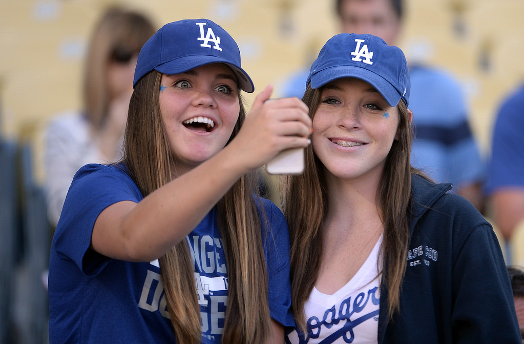 Description of . Los Angeles Dodgers fans take a selfie prior to a Major league baseball game between the San Diego Padres and the Los Angeles Dodgers on Saturday, July 12, 2014 in Los Angeles.   (Keith Birmingham/Pasadena Star-News)