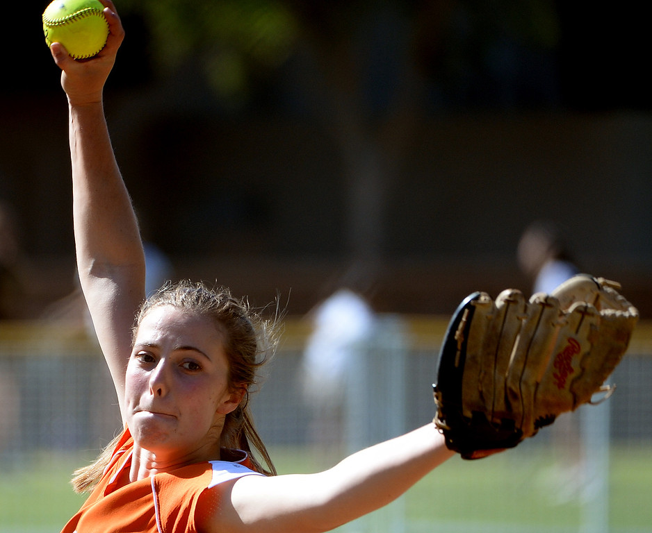 Description of . Poly starting pitcher DeeDee Logan throws to the plate against Westridge in the first inning of a prep softball game at Westridge High School in Pasadena, Ca on Tuesday, April 15, 2014. Poly won 11-1. (Keith Birmingham Pasadena Star-News)