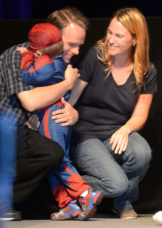 Description of . (Will Lester/Inland Valley Daily Bulletin) Jacob Long, 5, is hugged by his father Josh, as his mother Kaylene looks on, after completing his dream wish Thursday in Ontario. Jacob Long, 5 from Mira Loma, dream of fighting along side his favorite superhero, Spiderman, came true Thursday August 22, 2013 by the Make-A-Wish Orange County/Inland Empire along with assistance from the Ontario police and fire departments. At 15 months Jacob was diagnosed with an immune deficiency disease and has had to have 2 bone marrow transplants to cure it.