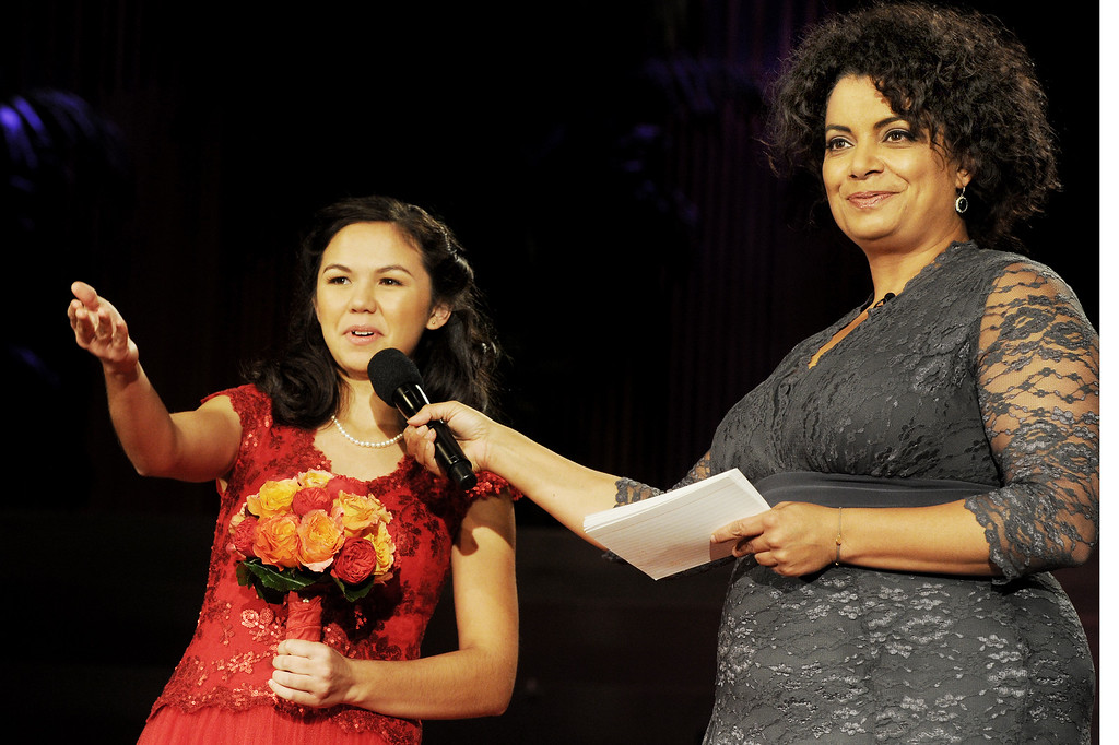 Description of . Rose Princess Jamie Ann Kwong, introducing her family while being interviewed by Michaela Pereira, CNN News Anchor,