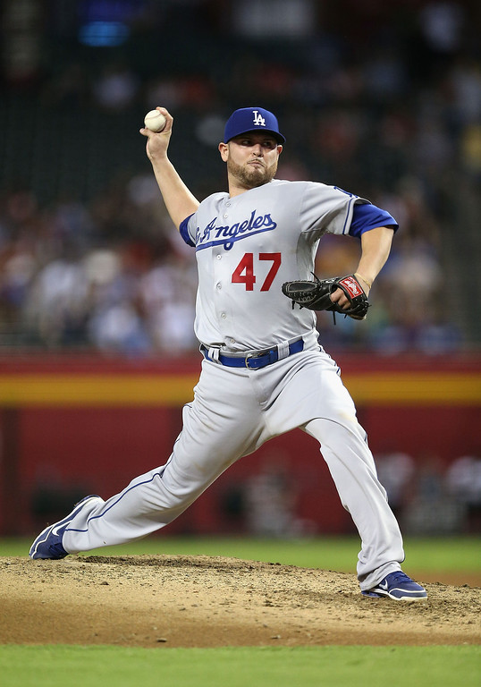 Description of . Starting pitcher Ricky Nolasco #47 of the Los Angeles Dodgers pitches against the Arizona Diamondbacks during the MLB game at Chase Field on July 9, 2013 in Phoenix, Arizona. The Dodgers defeated the Diamondbacks 6-1.  (Photo by Christian Petersen/Getty Images)