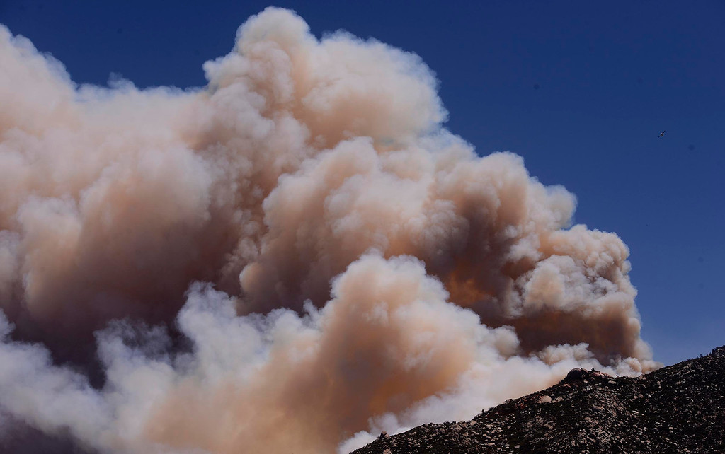 Description of . Smoke from the Silver Fire billows atop a ridge as seen from Twin Pines Ranch in the mountains south of Banning August 8, 2013.   GABRIEL LUIS ACOSTA/STAFF PHOTOGRAPHER.