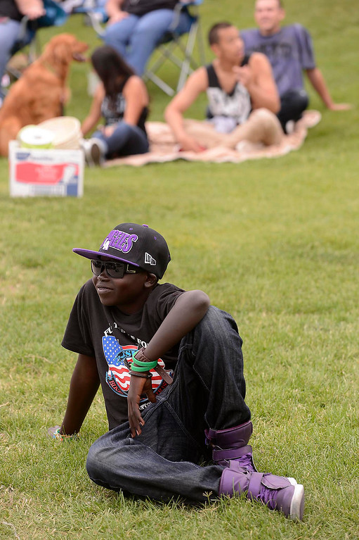Description of . Sudanese refugee Walter listens to Sam Childers speak during the Lifepoint Church's Picnic at Red Hill Community Park in Rancho Cucamonga May 5, 2013.   GABRIEL LUIS ACOSTA/STAFF PHOTOGRAPHER.
