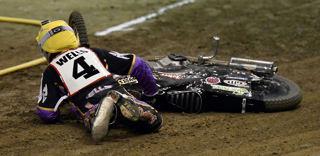 Description of . Ricky Wells goes down in the first race during the Monster Energy Speedway Cycles at the Industry Speedway in the Industry Hills Grand Arena in Industry, Calif., on Saturday, Dec. 28, 2013.     (Keith Birmingham Pasadena Star-News)