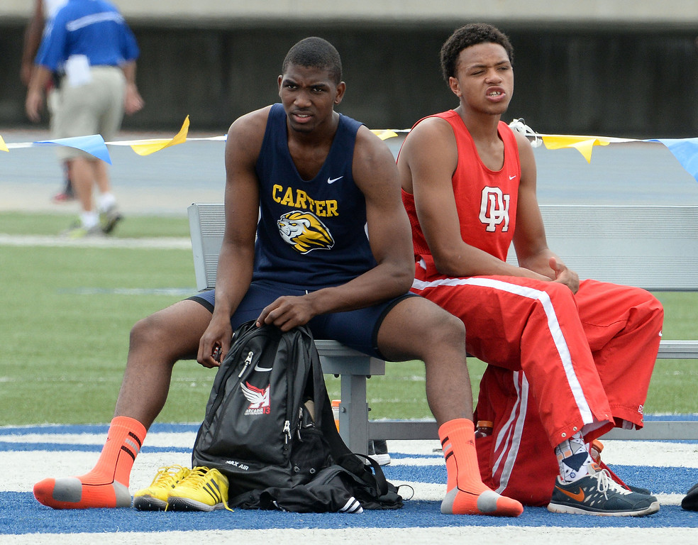 Description of . Carter's Eric Moore after competing in the division 2 high jump during the CIF Southern Section track and final Championships at Cerritos College in Norwalk, Calif., on Saturday, May 24, 2014. 