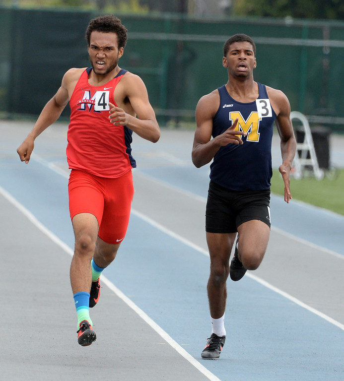 Description of . Maranatha's Kyle Brown, left, along with Muir's Marcelles Clash competes in the division 4 400 meters race during the CIF Southern Section track and final Championships at Cerritos College in Norwalk, Calif., Saturday, May 24, 2014. 