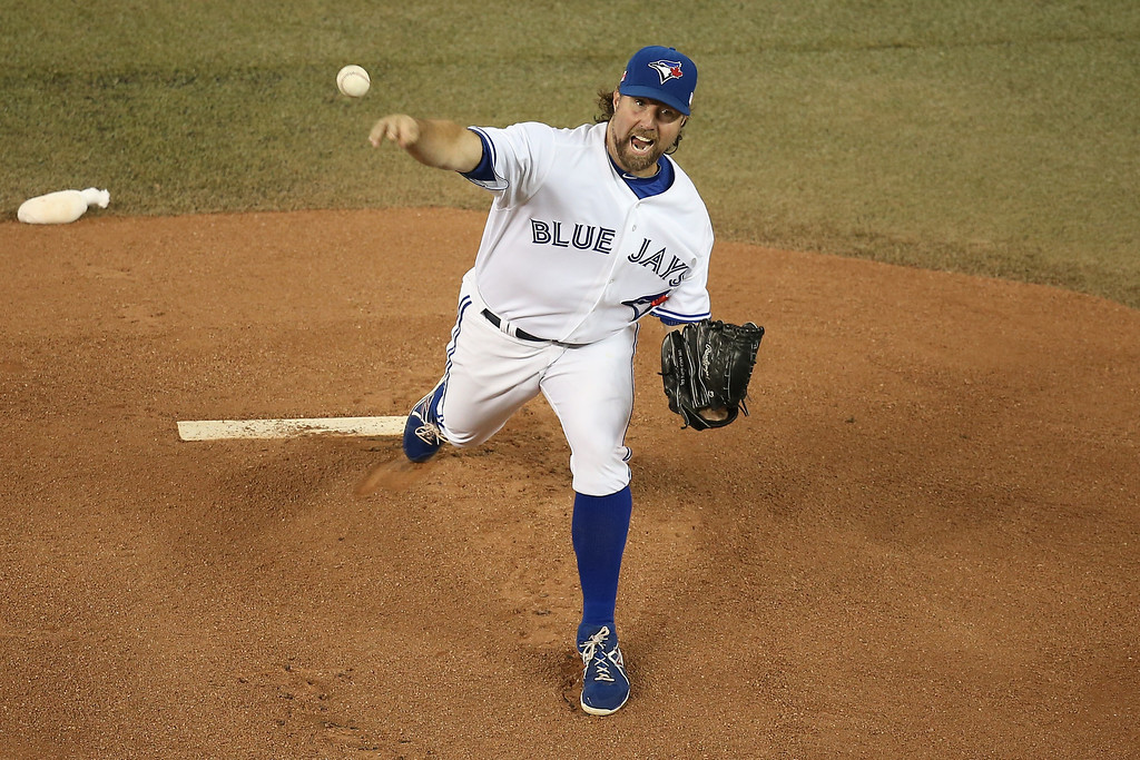 Description of . TORONTO, CANADA - SEPTEMBER 11: R.A. Dickey #43 of the Toronto Blue Jays delivers a pitch during MLB game action against the Los Angeles Angels of Anaheim on September 11, 2013 at Rogers Centre in Toronto, Ontario, Canada. (Photo by Tom Szczerbowski/Getty Images)