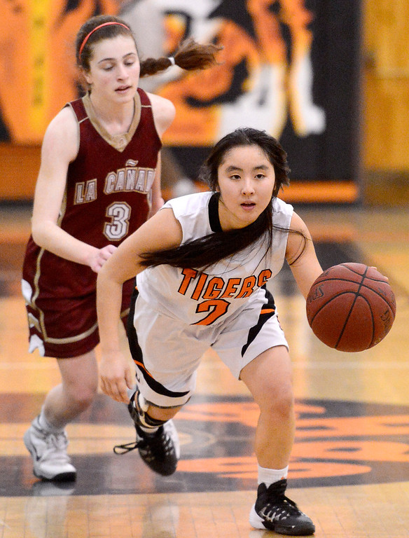 Description of . La Canada's Sarah Kurdoghlian (3) trails South Pasadena's Elise Takahama (2) as she drives the ball  during South Pasadena's 66-58 win Friday night, January 31, 2014 at South Pasadena High School. (Photo by Sarah Reingewirtz/Pasadena Star-News)