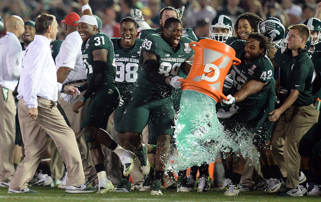 Description of . Michigan State Michigan State head coach Mark Dantonio avoids being drenched as the clock runs out during the 100th Rose Bowl game in Pasadena Wednesday, January 1, 2014. Michigan State defeated Stanford 24-20. (Photo by Hans Gutknecht/Los Angeles Daily News)