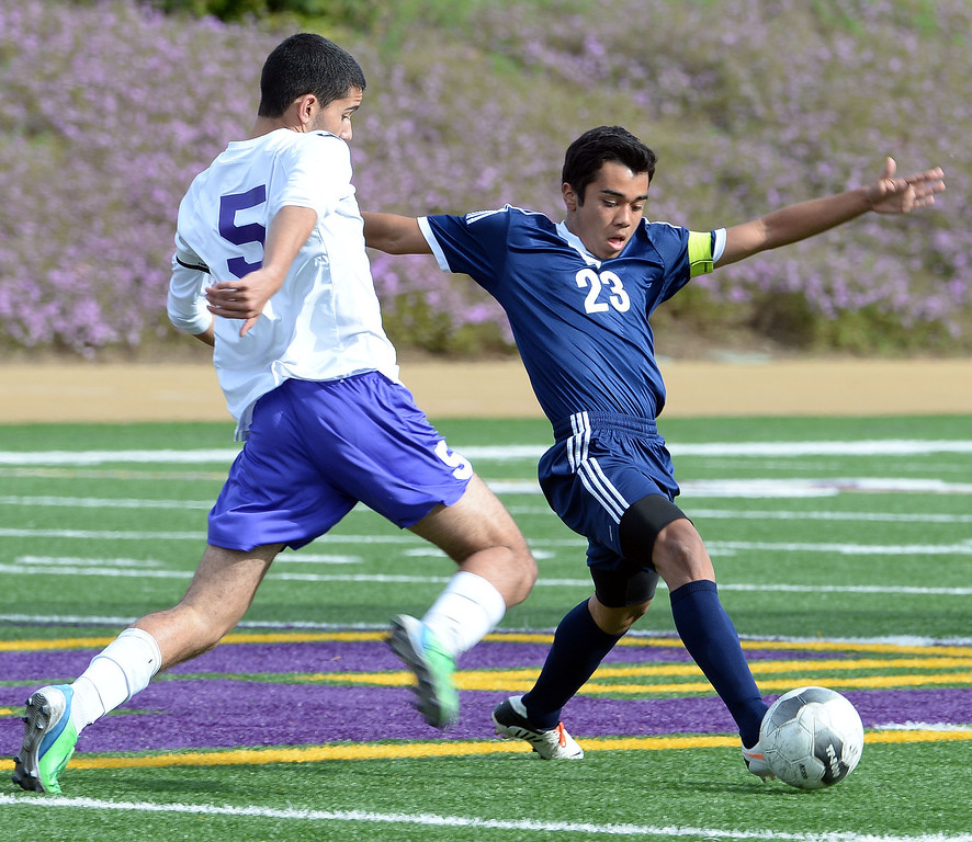 Description of . Baldwin Park's Javier Jasso (23) controls the ball past Diamond Bar's Spenser Brose (C) (5) in the first half of a CIF-SS quarterfinal prep playoff soccer match at Diamond Bar High School in Diamond Bar, Calif., on Thursday, Feb.27, 2014. Baldwin Park won 2-1. (Keith Birmingham Pasadena Star-News)