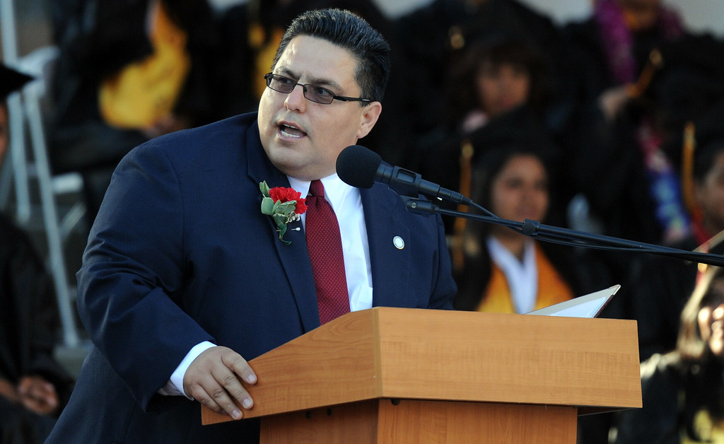 Description of . Hector A. Chacon, President, Board of Eduction speaks during the Vail High School commencement at Vail High School on Tuesday, June 18, 2013 in Montebello, Calif.