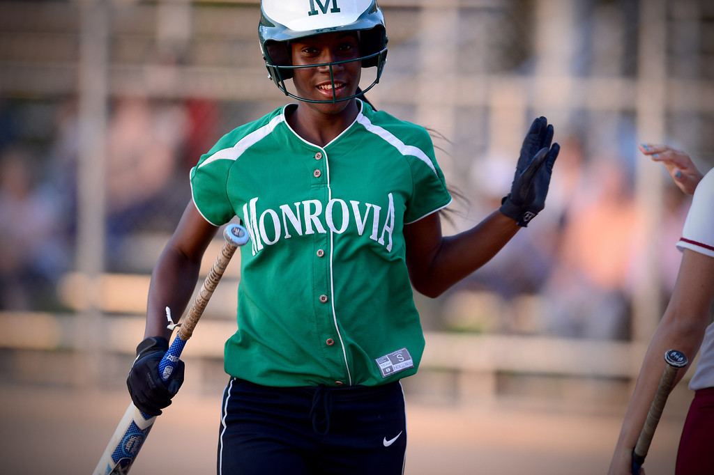 Description of . Monrovia's Elise McCarthy (4) during the West SGV softball all-star game Wednesday night, June 11, 2014 at Live Oak Park in Temple City. (Photo by Sarah Reingewirtz/Pasadena Star-News)
