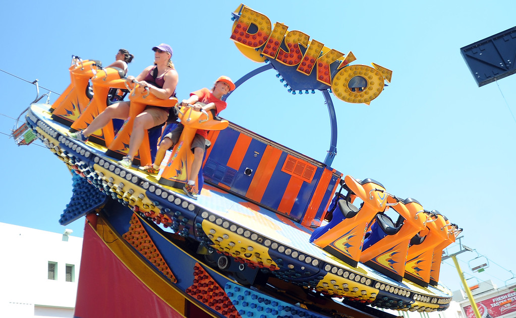 Description of . Beret Malmgren, left, with ten year-old Jep Spiewak have fun riding the Disko ride during the 91st Annual L.A. County Fair in Pomona, Calif. on Thursday, Sept. 5, 2013.   (Photo by Keith Birmingham/Pasadena Star-News)
